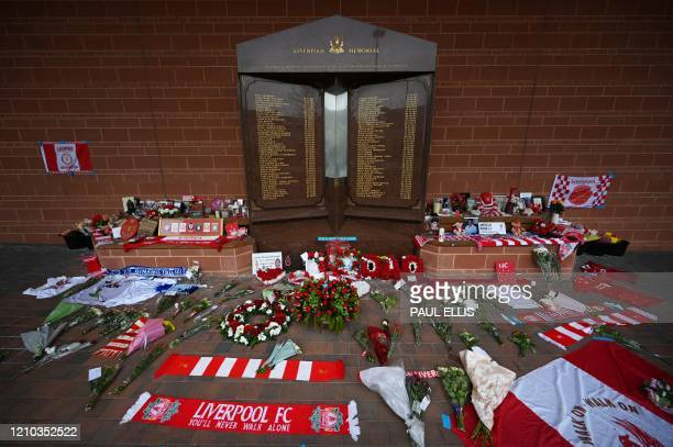 A picture shows tributes laid around the memorial to those who were killed in the 1989 Hillsborough Stadium disaster at Liverpool football club's...