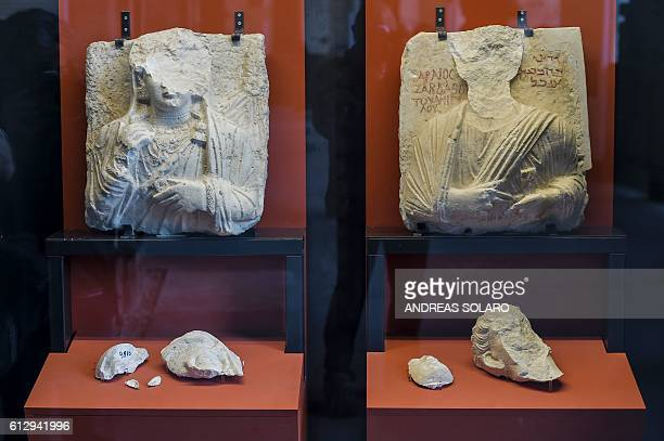 """Picture shows two busts whose faces were hammered away by Isis members at Palmyra's Museum in Syria, as part of an exhibition called """"Rising from..."""
