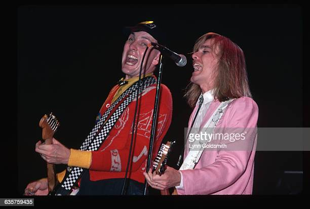 1980 Picture shows two members of the band Cheap Trick Rick Neilsen and Robin Zander performing on stage They are both playing the guitar and singing...