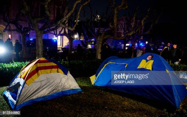 Picture shows two tents with masks depicting ousted separatist leader Carles Puigdemont set up outside the Catalan parliament at the Ciutadella park...