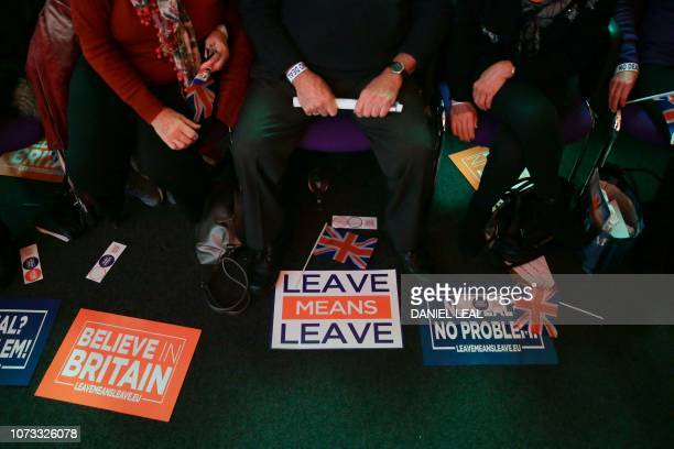 TOPSHOT A picture shows Union flags stickers and banners with slogans as campaign materials at a political rally organised by the proBrexit Leave...