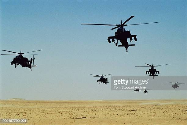 Picture shows US Apache attack helicopters carrying Hellfire missiles over the Saudi desert before the allied intervention of Kuwait during the...