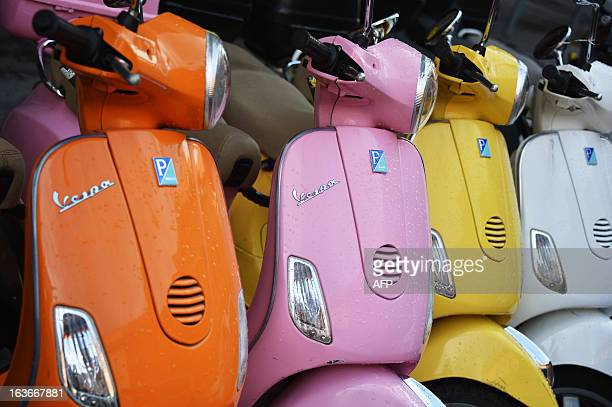 Picture shows Vespa's scooters of different colors on March 14, 2013 in Rome. AFP PHOTO / GABRIEL BOUYS