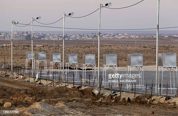 A picture shows water tanks at a partially set up camp in Mafraq city near Jordan's northern border with Syria on February 20 2012 as the desert...