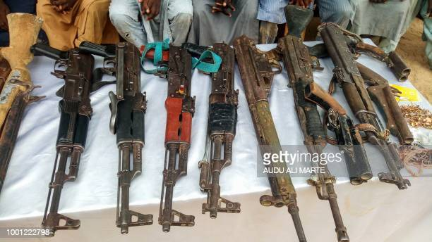 A picture shows weapons allegedly belonging to a group of suspected Boko Haram militants displayed by the police officers in Maiduguri northeast...