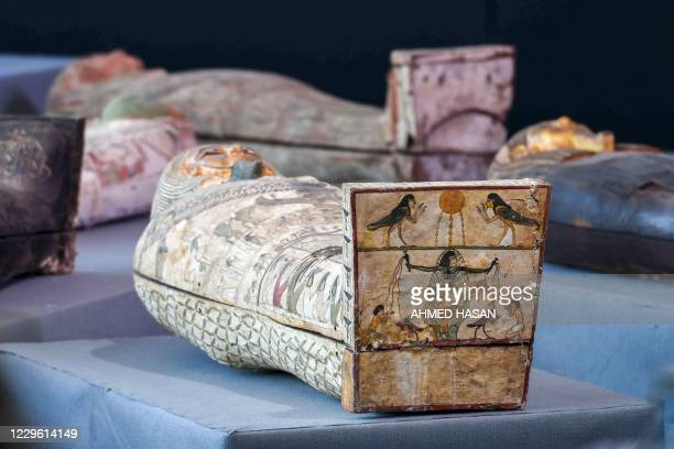 Picture shows wooden sarcophagi during the unveiling of an ancient treasure trove of more than a 100 intact sarcophagi, at the Saqqara necropolis 30...