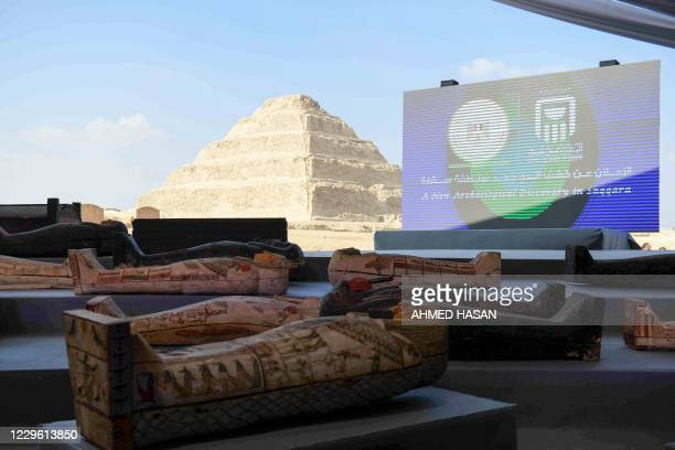 A picture shows wooden sarcophagi on display during the unveiling of an ancient treasure trove of more than a 100 intact sarcophagi at the Saqqara...