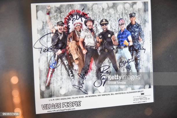 A picture signed by the Village People as a detail during the Aline Reimer Foundation Gala on July 7 2018 in Berlin Germany