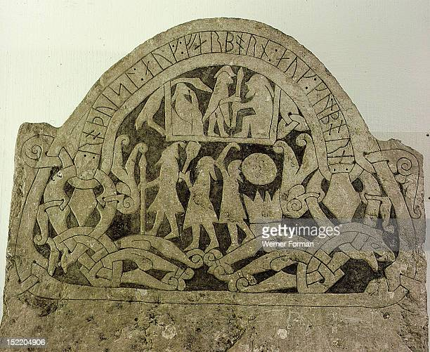 Picture stone with runic writing across the top It has been suggested that the standing figure in the house is Odin He is with Ermaneric the Goth who...