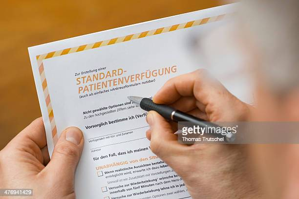 Picture symbolizing advance health care directive a man filling out an advance health care directive on March 05 2014 in Berlin Germany An advance...