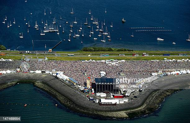 A picture take on June 30 2012 shows an aerial view of the Dutch music festival 'Concert at Sea' in Scharendijke on June 30 2012 The festival is sold...