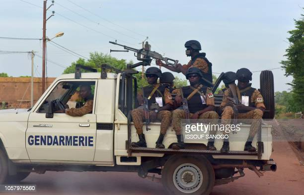 Picture take on October 30, 2018 shows Burkinabe gendarmes sitting on their vehicle in the city of Ouhigouya in the north of the country. - Two...