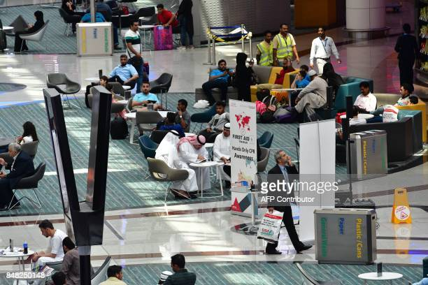 A picture take on September 14 2017 shows a general view of terminal 1 at Dubai's International Airport / AFP PHOTO / GIUSEPPE CACACE