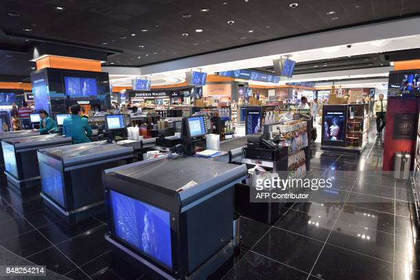 A picture take on September 14 2017 shows a general view of the Duty Free shop at Dubai's International Airport / AFP PHOTO / GIUSEPPE CACACE