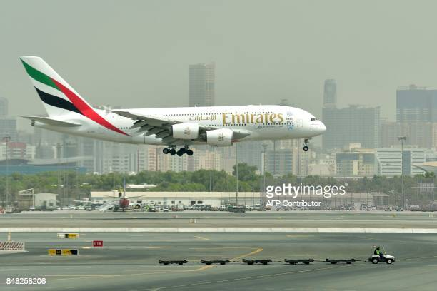 A picture take on September 14 2017 shows an Airbus A380 of Emirates landing at the tarmac at Dubai's International Airport CACACE