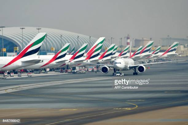 A picture take on September 14 2017 shows Emirates planes parked at the tarmac at Dubai's International Airport CACACE