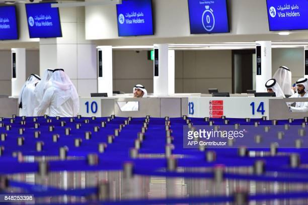A picture take on September 14 2017 shows passport control counters at Dubai's International Airport / AFP PHOTO / GIUSEPPE CACACE