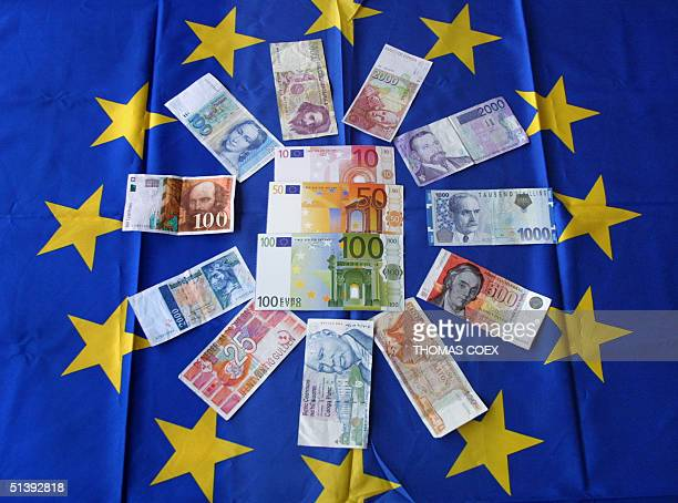 Picture taken 01 June 2001 of banknotes of the euro surrounded by banknotes and currencies of diverse European countries AFP PHOTO THOMAS COEX