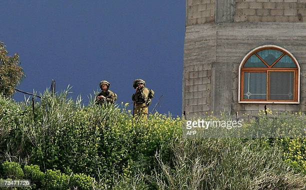 A picture taken 01 March 2007 in the Lebanese village of alWazzani Lebanese shows Israeli soldiers standing at their part of the border in southern...