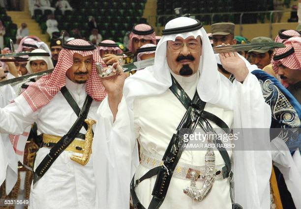 Picture taken 02 March 2005 shows Crown Prince Abdullah taking part in a traditional bedouin dance Ardha in Riyadh The popular crown prince has been...