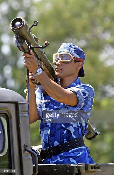 Picture taken 02 September 2003 of a Nicaraguan soldier carrying a SA7 antiaircraft missiles during a parade in Managua US Secretary of State Colin...