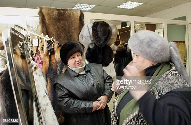 A picture taken 03 November 2005 shows woman trying fur hats at a farm in Pushkino some 40 kms from Moscow From Soviet leaders to high society icons...
