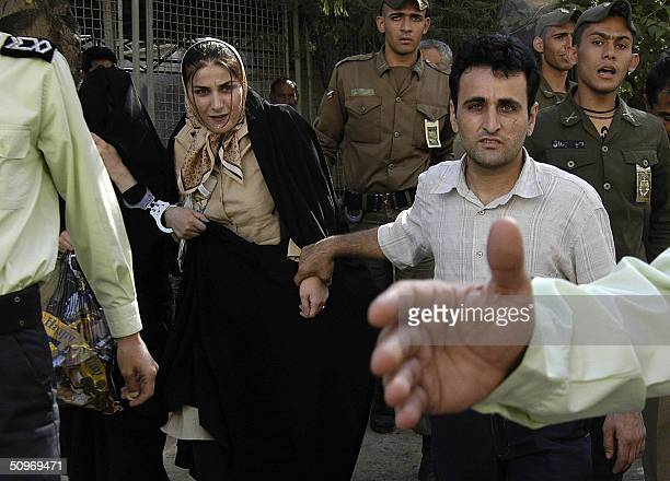 Picture taken 06 June 2004 shows Iranian Khadijeh Shahla Jahed the mistress of Iranian football star Nasser Mohammad Khani walking out of court...