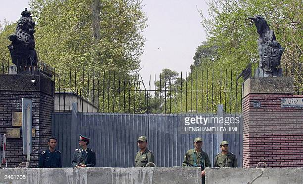 Picture taken 07 April 2003 shows Iranian police standing guard in front of the British Embassy as Iranian students from the Marvi seminary in...
