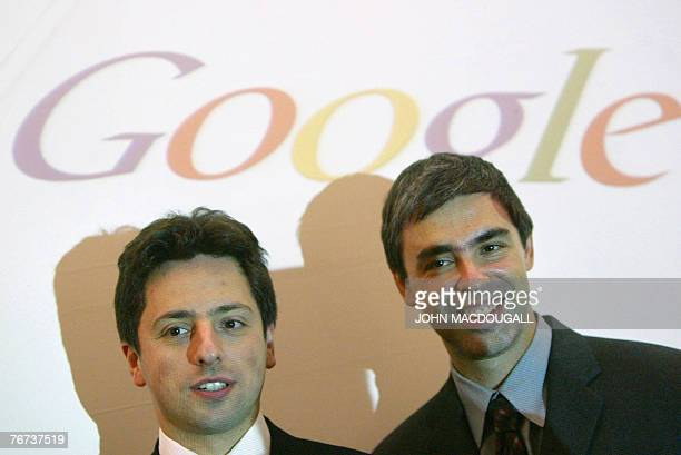 BENHAMOU FILES Picture taken 07 October 2004 shows Google founders Sergey Brin and Larry Page posing for photographers prior to presenting their new...
