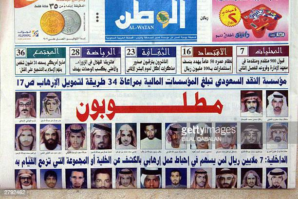 Picture taken 08 December 2003 shows front page of al-Watan newspaper with pictures of wanted Saudis. Two suspected Islamist extremists were killed...