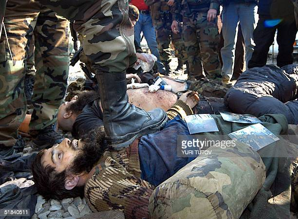 A picture taken 08 November 2004 in Gudermes shows dead bodies of Chechen rebels which were killed by soldiers of Chechen President Akhmad Kadyrov...
