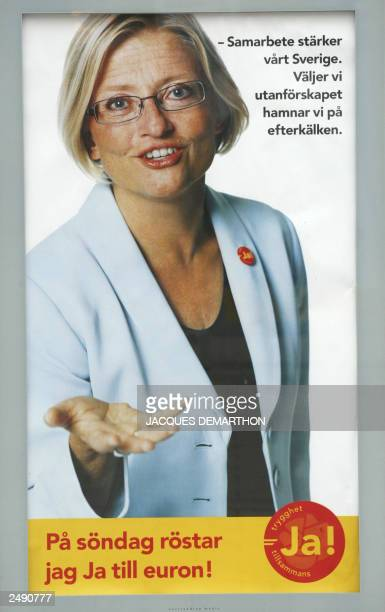 Picture taken 11 September 2003 of a poster of Foreign Minister Anna Lindh in Stockholm inviting Swedish people to vote yes for the Euro Slogans read...