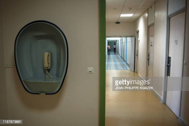 Picture taken 12 December 2006 in Saint Jean de Dieu pyschiatric hospital in Lyon shows a telephone in a hallway Created by the brothers of Saint...