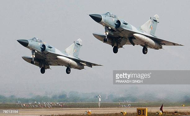 Picture taken 12 February 2003 of two Indian Air Force Mirage 2000 fighters taking off during the IndoFrance joint air force excercise at Gwalior 12...