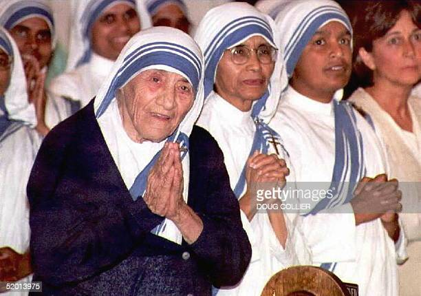 Picture taken 12 June 1996 shows Mother Teresa smiling during mass at the Sacred Heart Catholic Church in Atlanta, Georgia. Mother Teresa died 06...