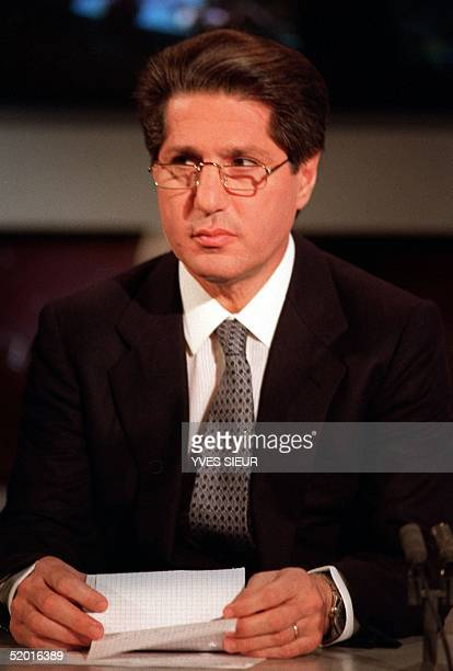 Picture taken 13 April 1989 of former Lebanese President Amine Gemayel speaking on the French TV TF1 news broadcast Gemayel who has lived in France...