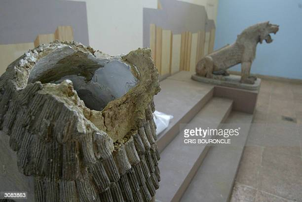 Picture taken 13 March 2004 shows the broken head of an Assyrian era lion which was damaged during the looting of Iraq's national museum in Baghdad...