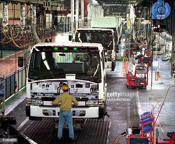 Picture taken 13 May shows an assembly line for Japan's Nissan Diesel Motor Co trucks at its main plant in Ageo Saitama Prefecture Nissan Motor Co...