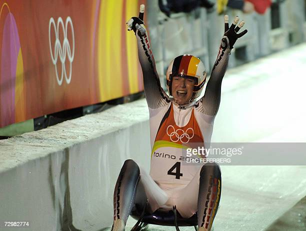 FILES A picture taken 14 February 2006 shows Germany's Sylke Otto celebrating after taking gold in the women's individual luge at the Turin 2006...