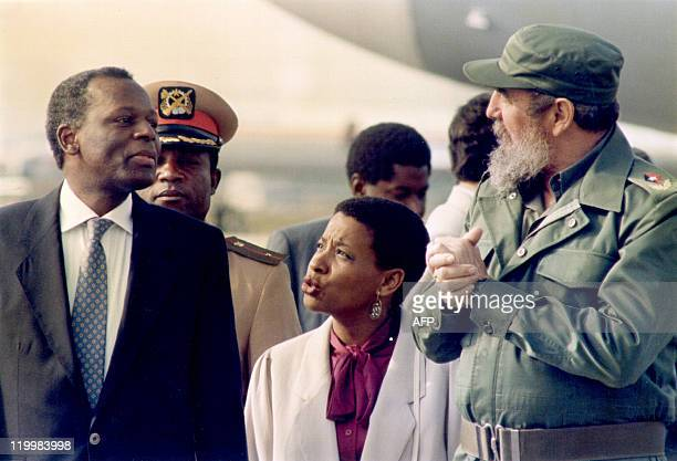 Picture taken 16 December 1988 of Cuban President Fidel Castro receiving Angola's Jose Eduardo Dos Santos at the Jose Marti International Airport in...