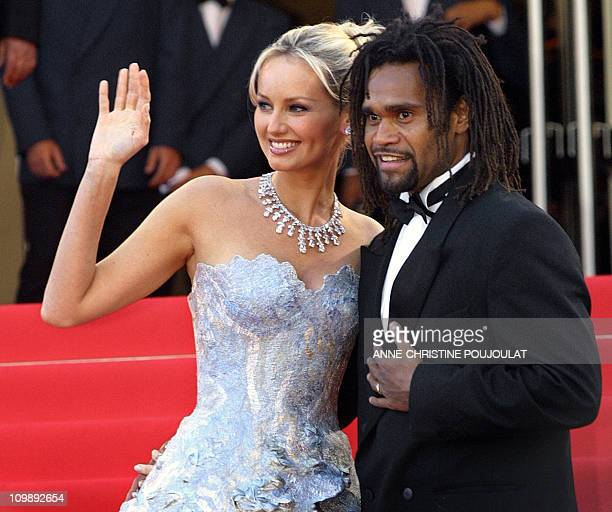 Picture taken 16 May 2002 in Cannes of French soccer player Christian karembeu and his wife topmodel Adriana Karembeu posing as they arrive at the...