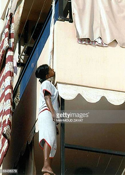 A picture taken 18 August 2005 shows a Sri Lankan teenager working as a maid in Lebanon after hanging herself from a balcony in the southern port...