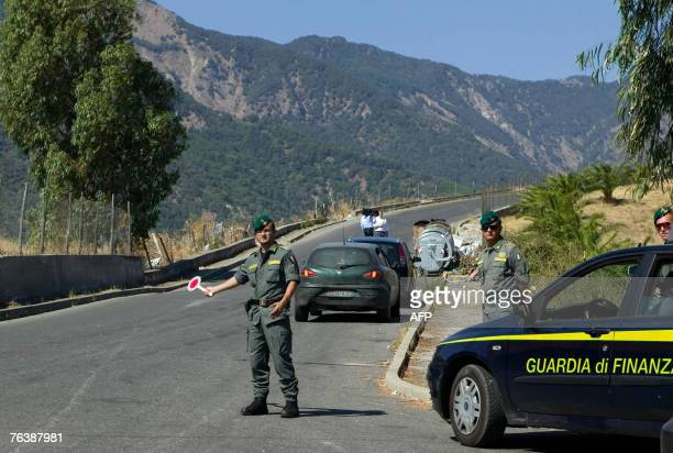 FILES A picture taken 18 August 2007 shows Italian police conducting a roadblock on the main street of San Luca village in the southern region of...