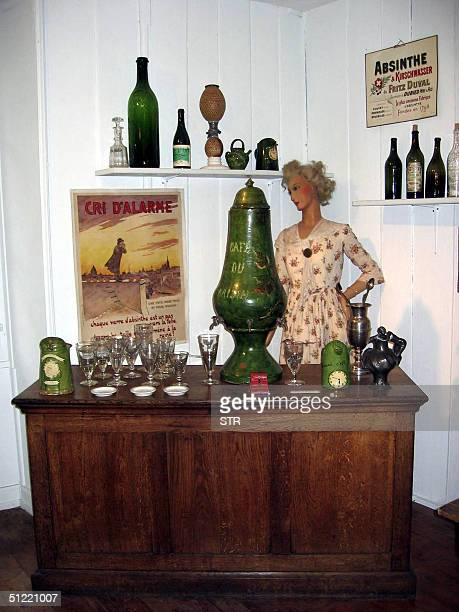 Picture taken 19 August 2004 shows a still used by clandestine producers in the ValdeTravers and water urn exhibited in the absinthe museum in...