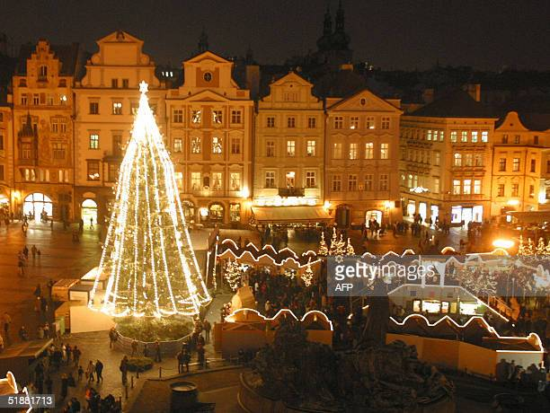 A picture taken 19 December 2004 shows Prague's Christmas market in the Old Town Square A 30meter tall evergreen dubbed Charles the Great this year's...