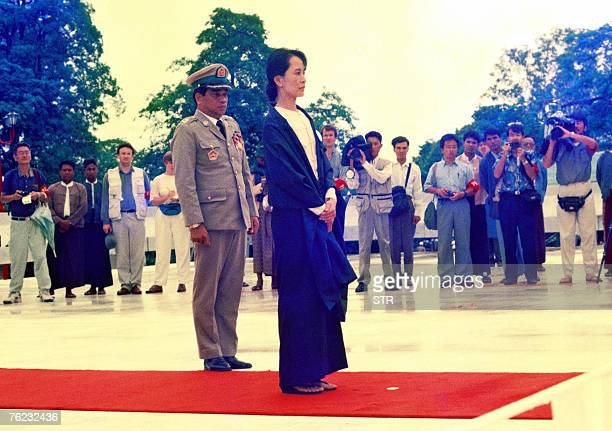 A picture taken 19 July 1995 shows Myanmar's detained democracy icon Aung San Suu Kyi paying respect to her late father General Aung San and other...