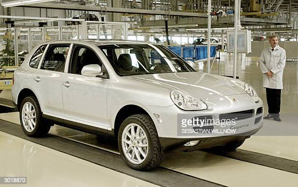 Picture taken 20 August 2002 shows the 4x4 Porsche Cayenne at the Porsche plant in the eastern town of Leipzig Porsche recalled 22158 units worldwide...