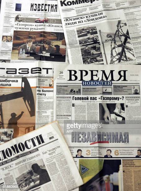 Picture taken 20 December 2004 shows front pages of Russian main newspapers with articles about mystery bidder, Baikalfinansgroup, which on Sunday...