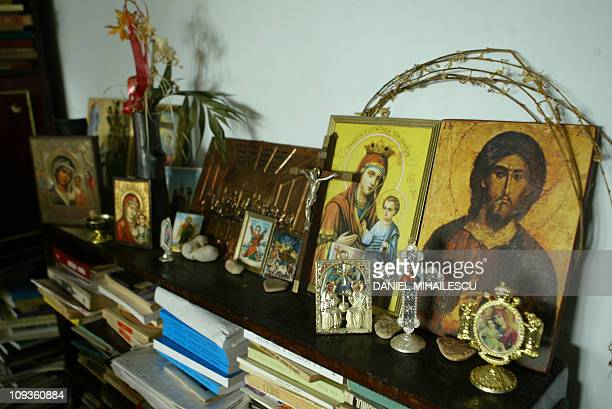 Picture taken 20 January 2005 of orthodox icons displayed in Adriana Illescu living room in Drumul Taberei quarter in Bucharest A 67yearold Romanian...