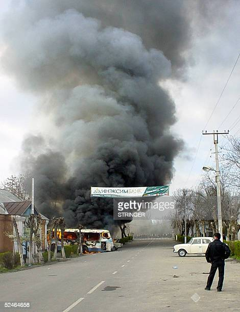 Picture taken 20 March 2005 shows a view of a burning police department building in the town of Jalal-Abad, southern Kyrgyzstan. Four demonstrators...